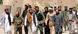 Taliban insurgents with national security forces