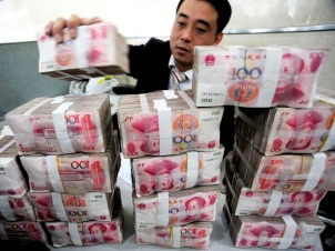 Counting renminbi, photo courtesy of Business Insider