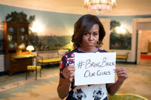 "First Lady Michelle Obama holding a sign with the hashtag ""#bringbackourgirls""; Source: Michelle Obama, Office of the First Lady via Wikipedia"