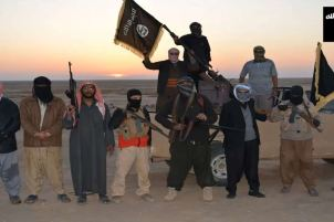 ISIS militants; Source: AFP via http://www.abc.net.au/news/2014-06-12/isis-militants-wave-a-flag-in-iraq/5519634